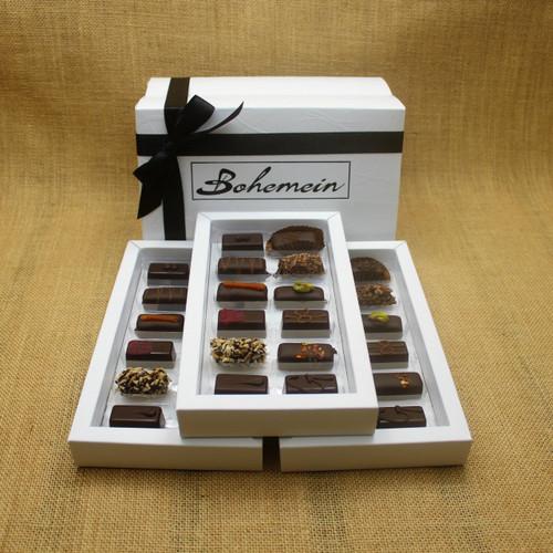 Bohemein 36 Dark  Chocolates Gift Box includes: Melting Passion Ganache x3, Coconut Cream Truffle x3, Raspberry Ganache x3, Rosemary and Apricot Ganache x3, Noisette (Hazelnut) x3, Creme de Menthe Fondant x3, Ginger Caramel x3, Chilli Ganache x3, Vanilla Cream - Dark x3, Pistachio Marzipan x3, Seventy Truffle x3, Cocoa Nib Caramel x3