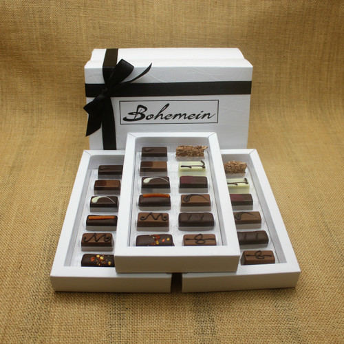 Bohemein Gift Box with 36 Nut Free Chocolates including: Chilli Ganache, Maple Cream, Rosemary and Apricot Ganache, Pineapple and Black Pepper Ganache, Chocolate Caramel, Melting Passion Ganache, Vanilla Cream - Milk, Balsamic Vinegar and Honey Ganache, Cointreau Ganache, Raspberry Ganache, Lemon and Thyme Ganache, Coffee Truffle