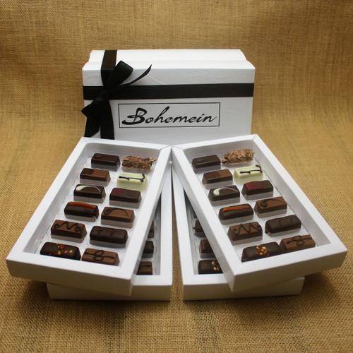 Bohemein Gift Box with 48 Nut Free Chocolates including: Chilli Ganache x4, Maple Cream x4, Rosemary and Apricot Ganache x4, Pineapple and Black Pepper Ganache x4, Chocolate Caramel x4, Melting Passion Ganache x4, Vanilla Cream - Milk x4, Balsamic Vinegar and Honey Ganache x4, Cointreau Ganache x4, Raspberry Ganache x4, Lemon and Thyme Ganache x4, Coffee Truffle x4