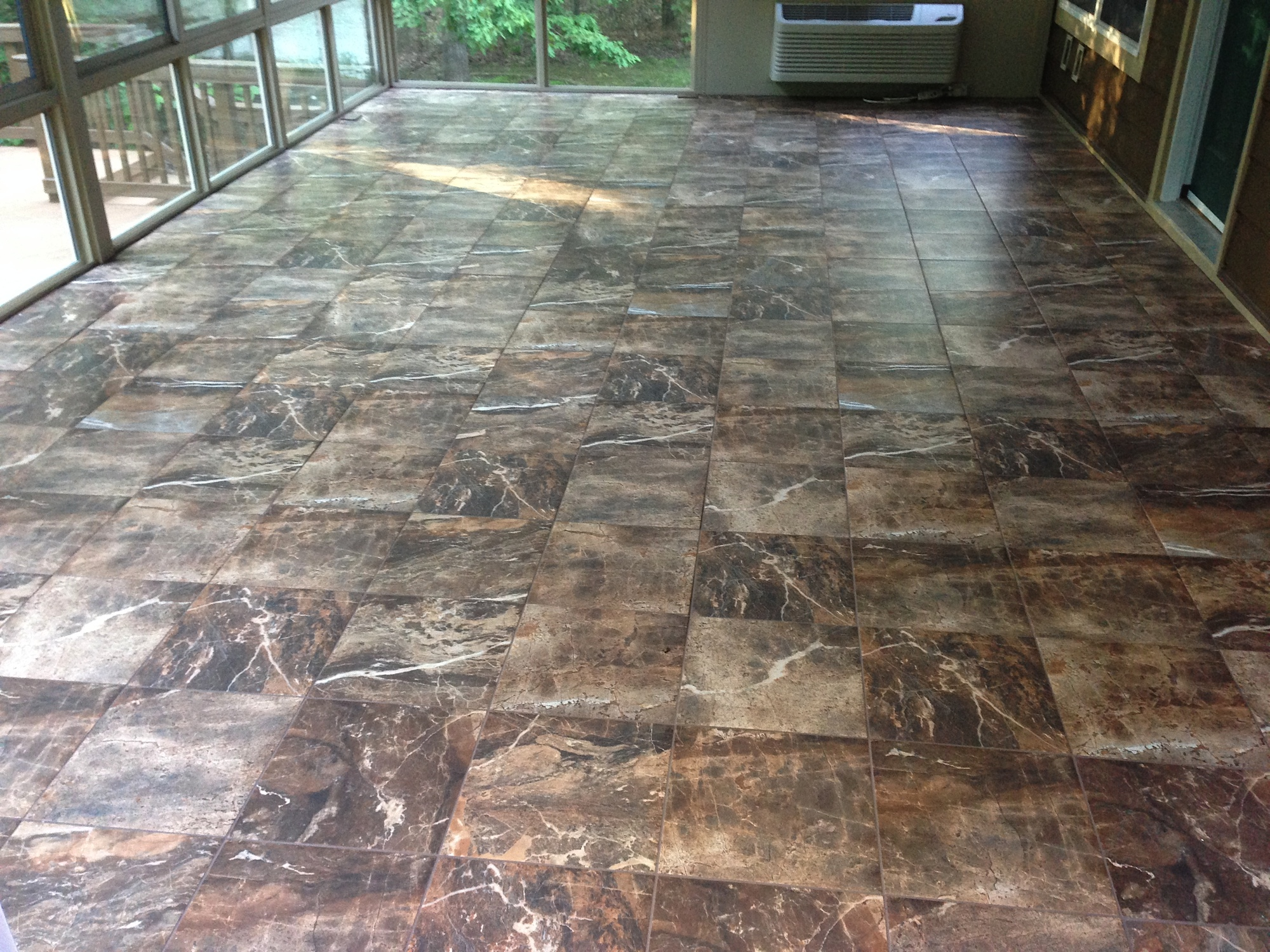 Renovation inspiration sunroom with 13x13 thrill rock warm heat heres the finished floor the tiles shown here is the 13x13 thrill collection in the color rock the grout is laticrete permacolor chocolate truffle not dailygadgetfo Choice Image