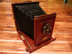 SOLD - Universal 6.5 x 8.5 Folding Wood Field Camera + Bausch & Lomb Lens
