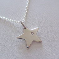 Sterling Silver Star Charm Necklace with a Genuine 1 Point Diamond