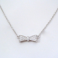 Sterling Silver Bow Tie Necklace with White CZ Stones