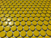 Yellow penny round tiles