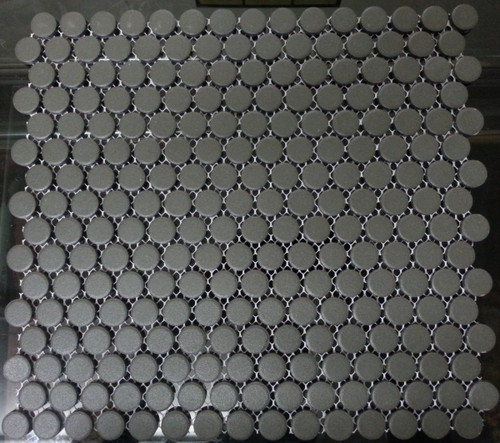 Unglazed black penny round mosaic tiles