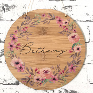 A Personalised watercolour wreath bamboo plywood wall hanging