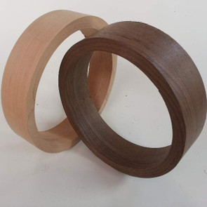 Banjo rims in maple and walnut show coarse turned
