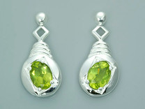 1.50 Ct.T.W. Genuine Oval Shape Peridot in Sterling Silver Earrings Style SE6802
