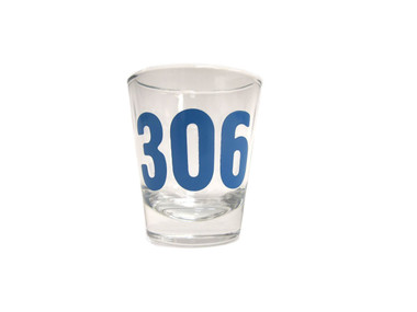 A clear shot glass with the numbers 3 0 6 imprinted in blue. 3 0 6 is the room in which Dr. King stayed when he was killed at the Lorraine Motel.