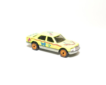 Hot Wheels Revealers Mercedes 380 SEL Day Glo Yellow with Orange UH wheels, loose