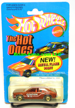 "Hot Wheels Metalflake Red/Brown Chevy Citation w/hogd wheels on ""The Ones Hot""card (ms3-577)"