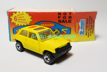 Bright Yellow Maggi Noodle Company Suzuki promotional car with its promo box