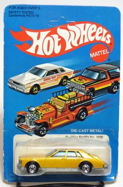 Hot Wheels Cadillac Seville, Metalflake Gold, BW wheels, Hong Kong base, unpunched card (608)
