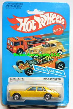 Hot Wheels Cadillac Seville, Metalflake Gold, Blackwall whls, Hong Kong, Mint on card