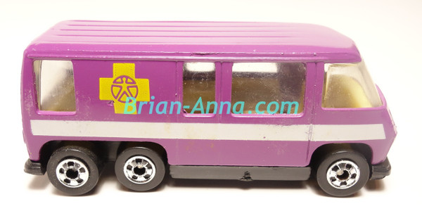 Purple GMC Motorhome, white stripe/yellow cross tampo's, loose