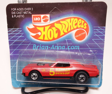 Hot Wheels Leo Mattel India, Red Torino Stocker with Yellow Kerker tampo on unpunched card