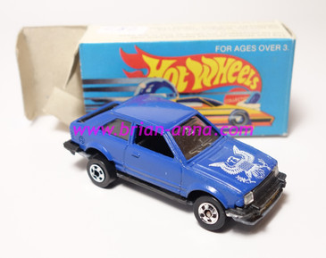 Hot Wheels Leo India Mattel Ford Escort, Dark Blue, White Eagle tampo, loose