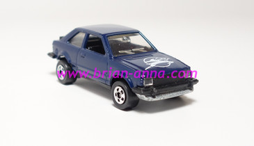 Hot Wheels Leo India Mattel Ford Escort, Dark Blue w/White Pierce Arrow style tampo loose