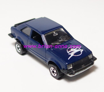 Hot Wheels Leo India Mattel Ford Escort, Dark Blue, w/Pierce Arrow style hood tampo, BW wheels, loose