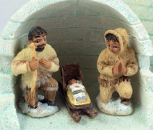 The costumes are a traditional Alaskan parka style, with a sled for Baby Jesus.