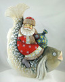 Grandfather Frost sitting on Fish