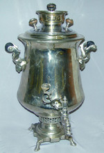 The body of the samovar is in excellent condition with mineral deposit in the interior due to frequent use. No maker's  marks are visible. The height of the samovar is approximately 54cm and the volume is approximately 7 liters.