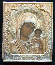 """The riza is marked with a silver mark  """"84""""  a maker's  mark (P.T.) and a right facing kokoshnik with triangle. The lower edge of the riza also has a full maker's mark for the V.S. Krestyaninov Factory, Moscow. The painting has been touched up in two places on the Madonna's face and there is some minor chipping of the paint where the riza has rubbed against the panel. The wood panel is covered at the back with faded red velvet."""