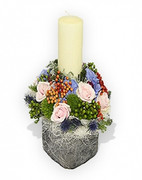 candle and flowers table arrangement