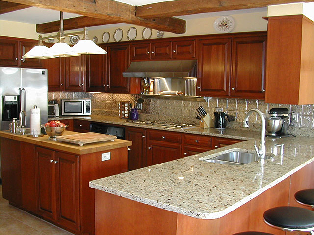 stained cabinets stainless steel aplicances and matching backsplash