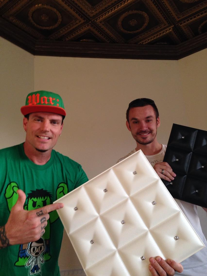 Vanilla Ice with Milan Jara are holding faux leather panels which are great for walls and headboards as well as ceilings.