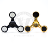 The straight-armed three-point Oni Fidget Hand Spinner in  Black and Gold.