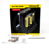 The Nitecore i8 packaging includes a warranty card and instruction booklet.