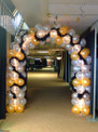 Balloon arch with lights and feather boas