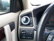 Charcoal driver's side Air Vent Gauge Pod installed in S60 with 52mm Glowshift boost gauge