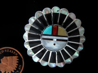 Sun Face pendant / pin in Sterling by Zuni artists Verdelle & Ester Niiha available at Sacred Bear Jewelry.