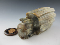 Rabbit in a log fetish carving by Zuni artist Arvella Cheama available at Sacred Bear Jewelry.