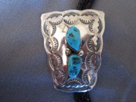 Bolo tie in Sterling bu Navajo artist Mike Thomas available from Sacred Bear Jewelry.