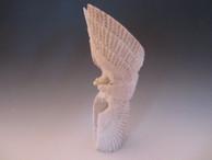 Eagles cartwheeling fetish carving from antler by Zuni artist Todd Lowsayatee.