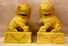 """Pair of Fu Dogs Carved in Soapstone This beautiful pair of Fu Dogs (Foo Dogs) are exquisitely carved in a yellow heavy river stone (soapstone). The Fu Dog was originally introduced to China with Buddhism, and has a close association with the Buddha and Chinese concepts of Feng Shui harmony. The mythical Fu Dog is a guardian creature that combines the ferocity of a lion with the loyalty of mans trusted canine, and has often been referred to as the """"Lion of Buddha"""". Fu Dogs add class and style to any environment whilst bringing thousands of years worth of protection. According to legend you should have both a male and a female Fu Dog to bring luck, prosperity and protection to your home or office. Each Fu Dog measures approximately 3.5""""W x 2.5""""D x 5.5""""H Item #FSE-ST-FD."""