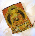 This bag comes in a gold/orange color, and has a satin buddha design on the front with a multi-colored fabric backing.