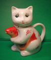 Teatime! Teatime! This darling porcelain lucky kitty is clutching her own lucky carp, whose mouth is the spout for the tea-pot. Cat lovers, this is for you!
