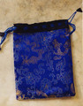 "Beautiful brocade drawstring bag with golden dragons woven into the fabric, in a beautiful blue. Lined. An excellent bag for tarot or other special items. Measures 6"" x 8""."