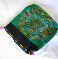 This dainty satin bag comes in an assortment of colors, with a mandala design on both sides.