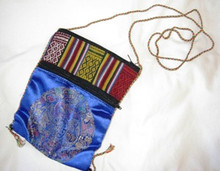 This bag has a satin mandala design on the front with a multi-colored fabric backing.