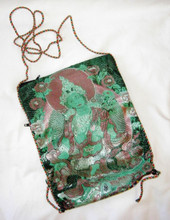 This satin bag comes in many colors, and is embroidered with the image of Green Tara, with a multi-colored fabric on the back.