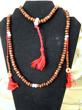 Light-colored Wood Mala, 108 beads, with white bone seperators. With counters.