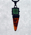 "A 1/2"" square of jewel-cut Moldavite atop an Amber obelisk."