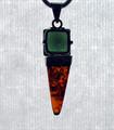 "A 1/2"" square of jewel-cut Moldavite atop an Amber obelisk."