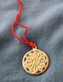 This pendant is made of brass, cast from an ancient talisman for protection and blessing,
