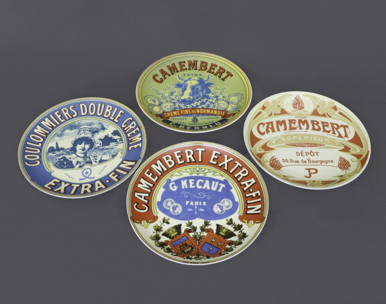 Four Smaller Cheese Serving Plates